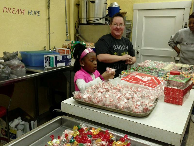 NCM Volunteers preparing for Drug-Free Gingerbread House Contest