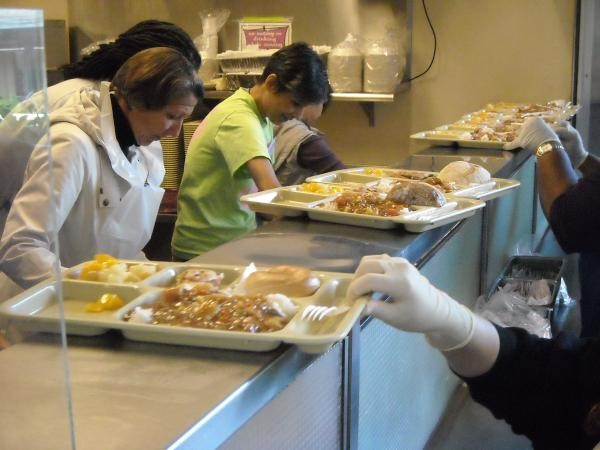 Volunteers help serve 1,000 hot lunches daily in the Free Dining Room.