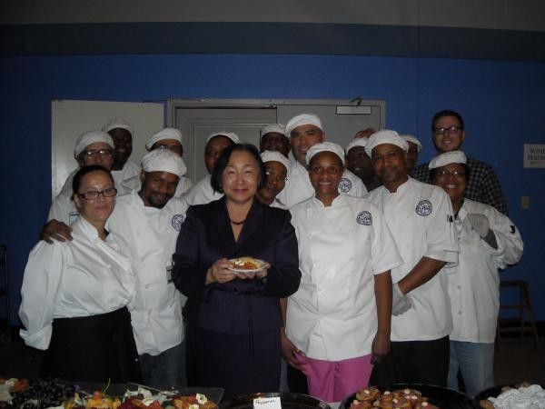 Oakland Mayor Jean Quan visits with SVdP's Kitchen of Champions Culinary Program students.