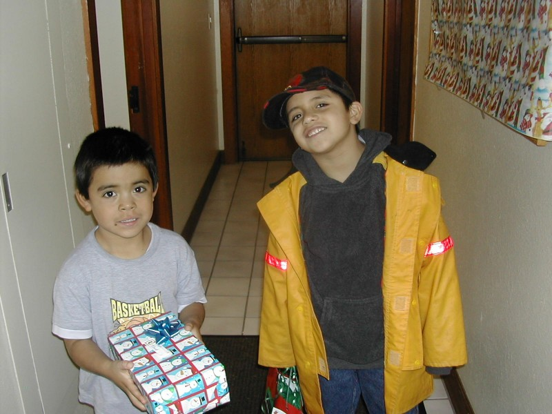 Two children participate in our food program