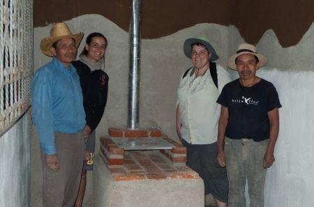 Bajareque walls (bamboo, stone, natural plaster) and clean-burning stove (replaces 3-stone fire) for elementary school in Guatemala