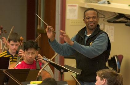 MYA Orchestra Director Patrick Pearson conducts a rehearsal
