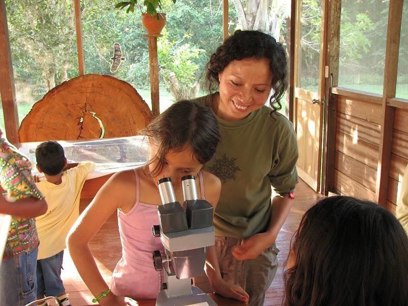 Peruvian PhD candidate Roxana Arauco teaching a local schoolgirl about ants during a