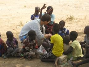 Catalyst Phillips Bragg with children in Nyarweng, Unity State, South Sudan.