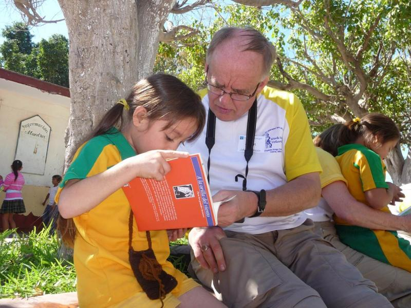 A Work-Week volunteer reads to a child in Mexico
