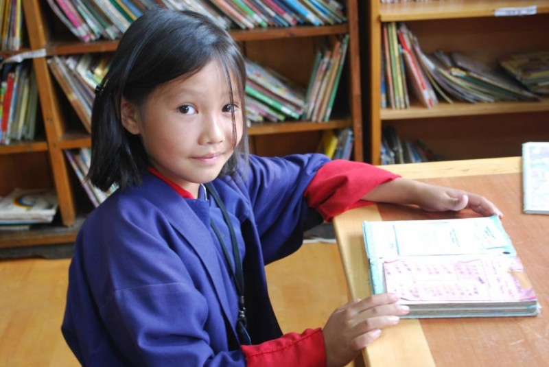 Girl reading in a READ Center in Bhutan