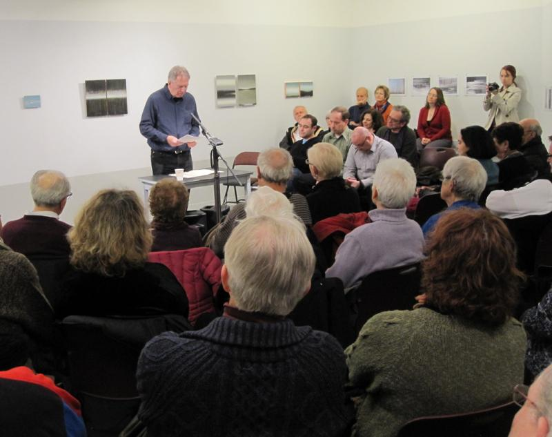 Local poet Stephen Anderson reads during a book release event, March 2012