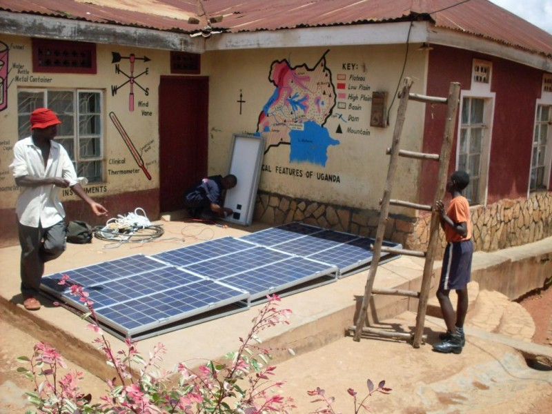 Preparing to install solar panels at Peace School