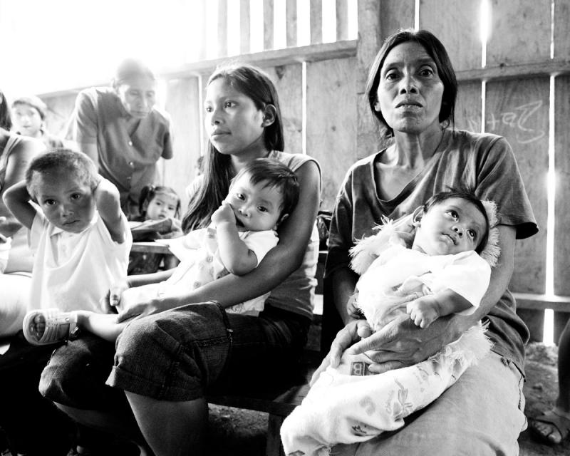 Mothers hold their children as they patiently wait to see a Rainbow Network doctor in rural Nicaragu