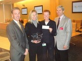 Dr. Elizabeth Claus accepts another check to continue her ongoing meningioma research.