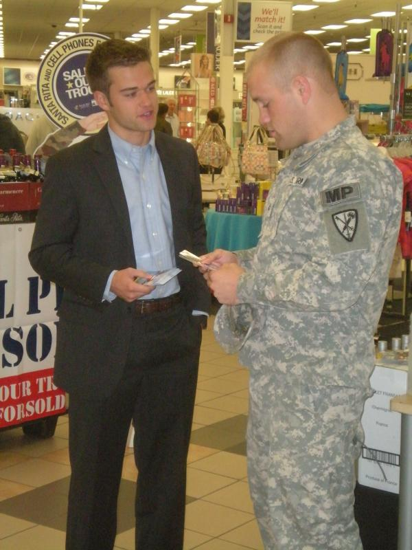 Donating calling cards to troops at Fort Lewis McChord.