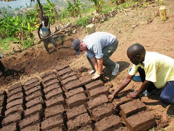 GO volunteer Ryan Gilpin helps build a home in Rwanda