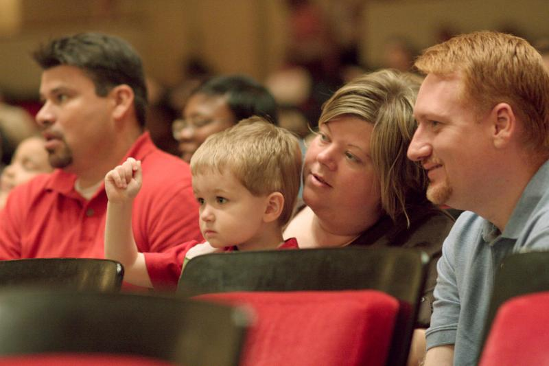 Children and parents enjoy a concert by the Space Coast Symphony Orchestra