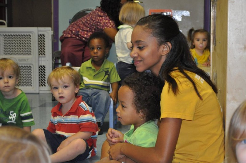 Young women participate in summer leadership program teaching preschool children about safety