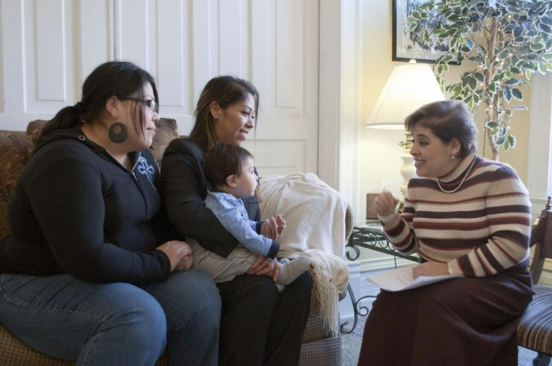 a Latino family receives help from a victim advocate