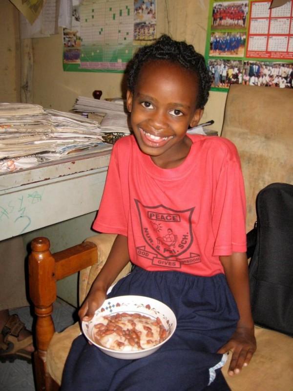 School girl eating  -  Peace School
