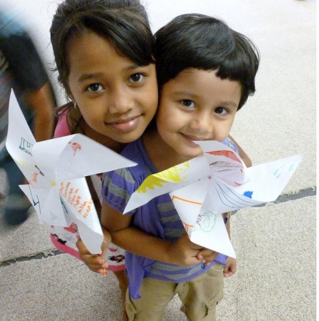 Bhutanese refugee sisters created Pinwheels of Hope with us.