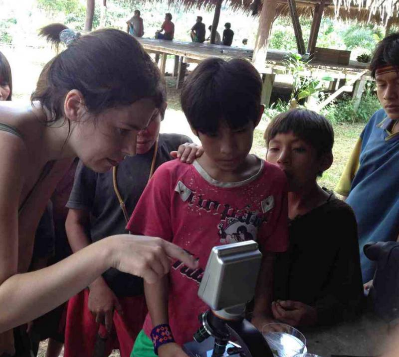 Dr. Ana Zeri shows children in Brazil's Amazon the excitement of microscopy.
