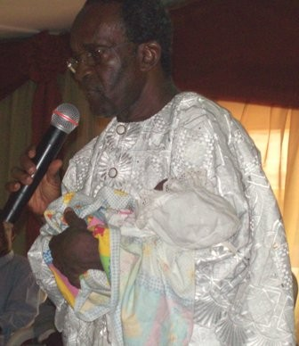 Rev Anyanwu with a blessing for the latest addition,