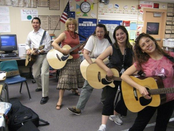 Teachers in a GITC Program having some fun with their guitars.