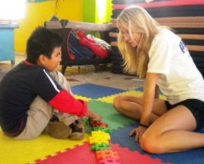 Jessica working with Lionel, a young boy with a visual impairment