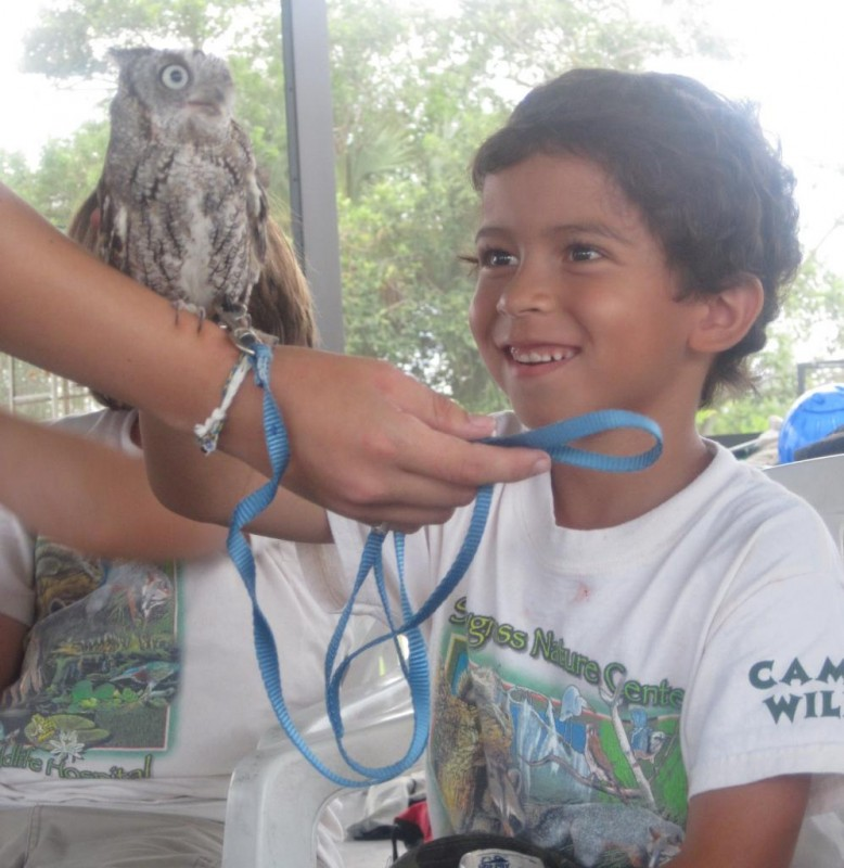 A camper gets to meet one of our Educational Ambassadors during one of our educational programs.