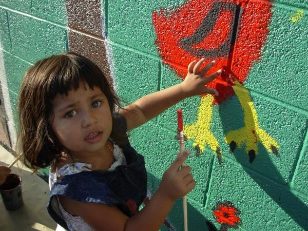Toddler paints mural at Rescue Mission Alliance emergency homeless shelter