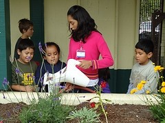 Kids plant a garden in our First Urban Summer Camp.