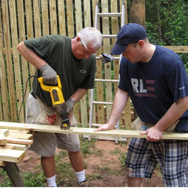 Volunteers build a new Raptor enclosure.