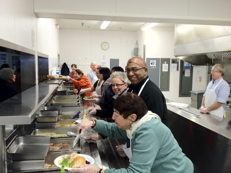 Volunteers at Bean's Cafe serving meal
