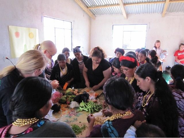 Local Guatemalan women and volunteers in a nutrition workshop