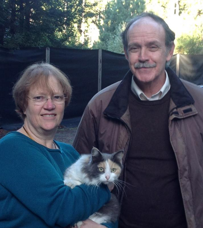 Volunteers Lenny & Steve delivering cat from1st leg of the rescue
