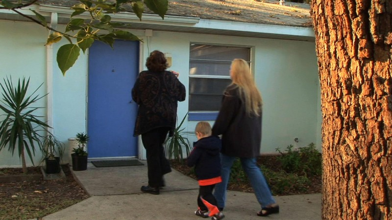 RCS Grace House staff move a new family into shelter