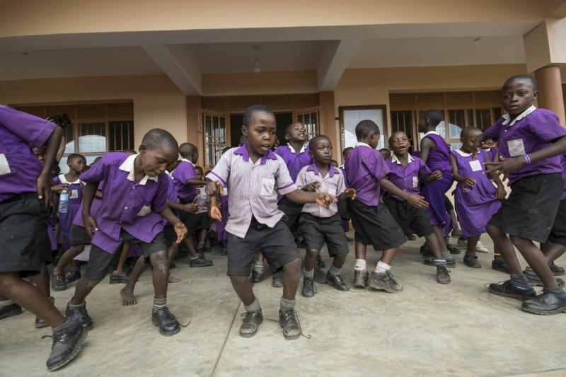 Nyaka Primary School students celebrate the official opening of the Nyaka Vocational Secondary School  (July, 2015)