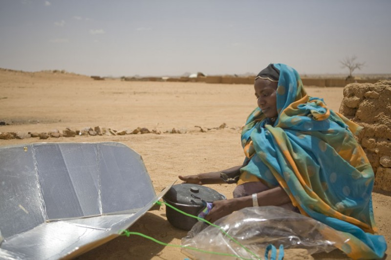 Barbara Grover took this amazing photo of a woman in the Iridimi refugee camp using her solar cooker