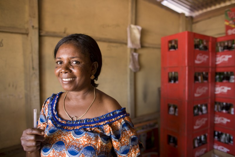 Theresa, a WomensTrust loan client in her shop