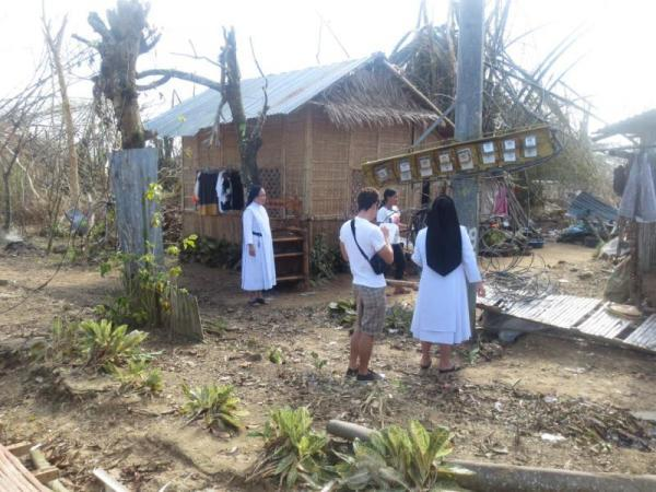 Sisters visiting typhoon victims after typhoon Haiyan/Yolanda.