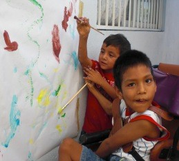 Axel and Cande painting together at our facility in Mazatlan