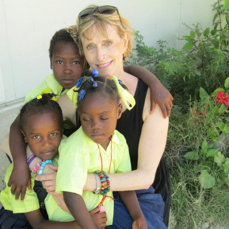 ArtReach art therapist with children in Haiti.