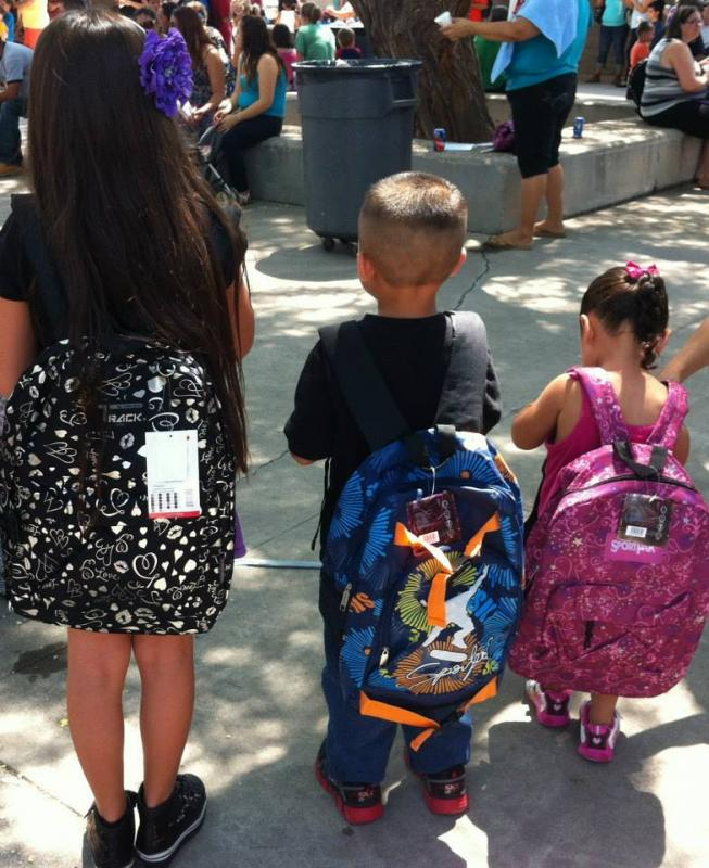 2500 children receive backpacks and supplies