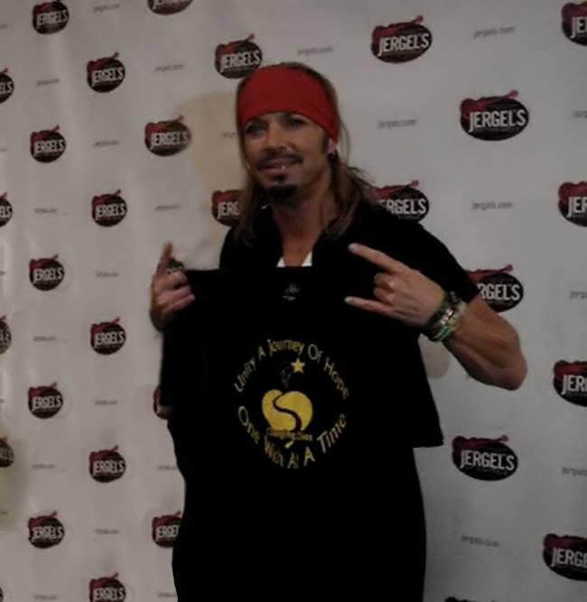 Bret Michaels - holding a Unity a Journey of Hope tshirt after meeting wish recipient