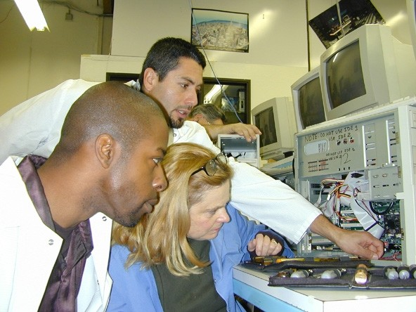 Students working to be Computer Service Technicians learn the equipment.