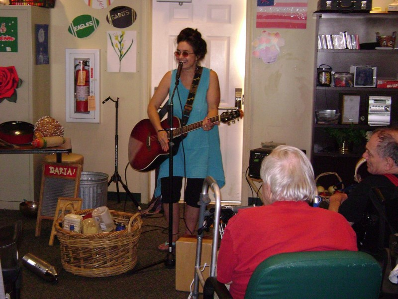 World Music artist Daria performs for a group of adults with developmental disabilities.