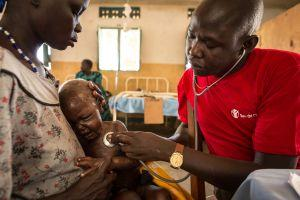 Nimule receives lifesaving care from a Save the Children worker in South Sudan, where conflict and famine-like conditions threaten children's lives.
