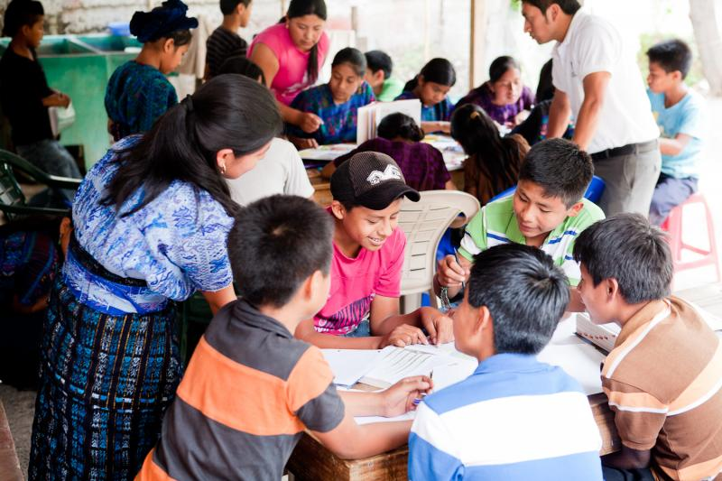 Students in the village of Santa Catarina participate in a reading activity at a library.