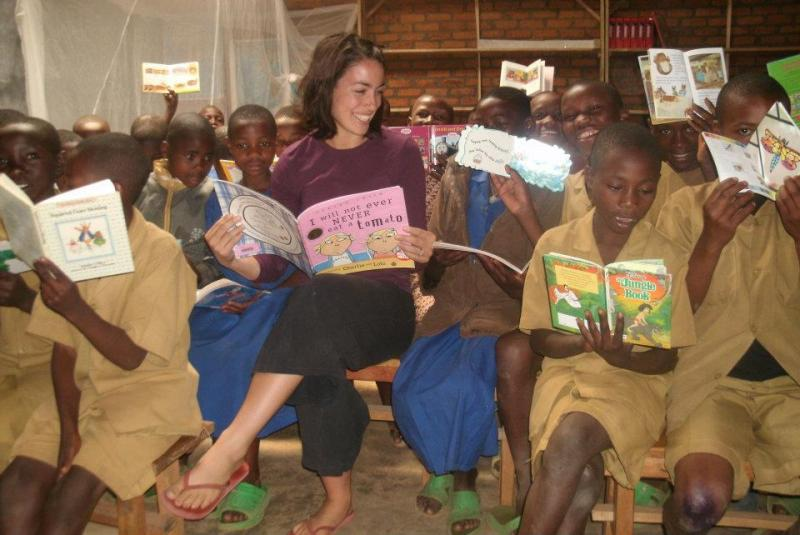 Frances Klinck reading with children at Mwiko Primary School in Rwanda.