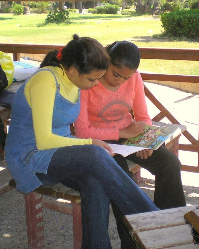A big sister in the Valuable Girl Project helps her litter sister learn to read.