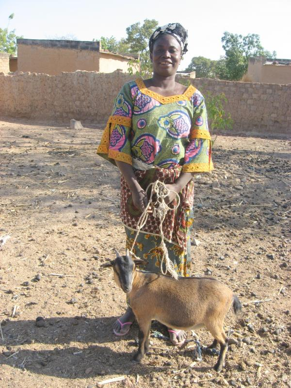 A woman who just received her goat