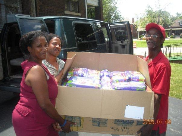 Volunteers at a partner nonprofit help unload a donation from