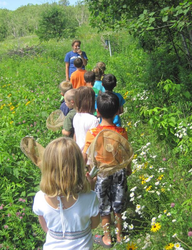 Exploring the prairie with youth.
